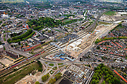 Nederland, Noord-Brabant, Breda, 09-05-2013; spoorzone Breda, station en omgeving.  Fyra rijdt station binnen.<br /> Via Breda,  ontwikkeling van de Spoorzone in het centrum van Breda. Het gebied rond het nieuw te bouwen station (architect Koen van Velsen) wordt een nieuw stadsdeel, naast de historische binnenstad van Breda.<br /> Via Breda, development of the railway zone in the center of Breda. The area around the new to be constructed railway station (architect Koen van Velsen) will be  a new residential district, next to the historic city of Breda.<br /> <br /> luchtfoto (toeslag op standard tarieven)<br /> aerial photo (additional fee required)<br /> copyright foto/photo Siebe Swart