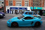 Sky blue Porsche supercar in London, United Kingdom.