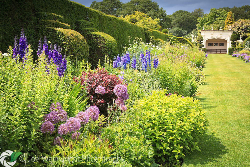 Clouds gather over the lush double herbaceous borders at Arley Hall and Gardens, Cheshire.  Photographed in June. .  This image is available for sale for editorial purposes, please contact me for more information.
