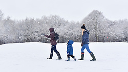 © Licensed to London News Pictures. 10/12/2017. London, UK. A family walk through a snow covered golf course as snow falls in Northwood, north west London.  The weather forecast predicts an accumulation of three to four inches with snow continuing to fall well into the afternoon.  Photo credit: Stephen Chung/LNP