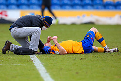 Ollie Clarke of Mansfield Town receives medical treatment - Mandatory by-line: Ryan Crockett/JMP - 20/02/2021 - FOOTBALL - One Call Stadium - Mansfield, England - Mansfield Town v Cambridge United - Sky Bet League Two