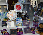 Shop window display of pottery and music DVDs from King's College, Cambridge, England