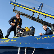 BRUNSWICK, Maine -- 9/4/15 -- Blue Angel #7 Crew Chief Ben Thayer helps Tim Gagnon, Brunswick High School Asst Principal, get ready to fly to Rangely as a Key Influencer -- as part of the Great State of Maine Air Show. <br /> Photo by Roger Duncan for The Forecaster.