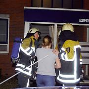 Keukenbrand Bovenmaatweg 20 Huizen, bewoonster in paniek, huilen, emotie, troost, troosten, brandweer