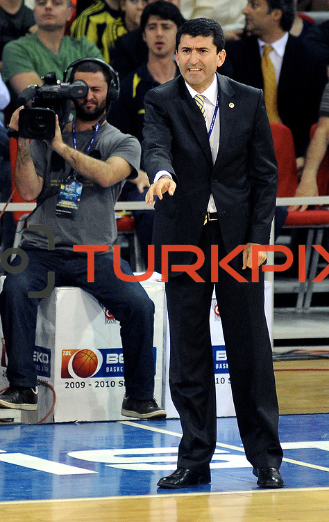 Fenerbahce Ulker's coach Ertugrul ERDOGAN during their Turkish Basketball league Play Off Final third leg match Fenerbahce Ulker between Efes Pilsen at the Abdi Ipekci Arena in Istanbul Turkey on Tuesday 25 May 2010. Photo by TURKPIX