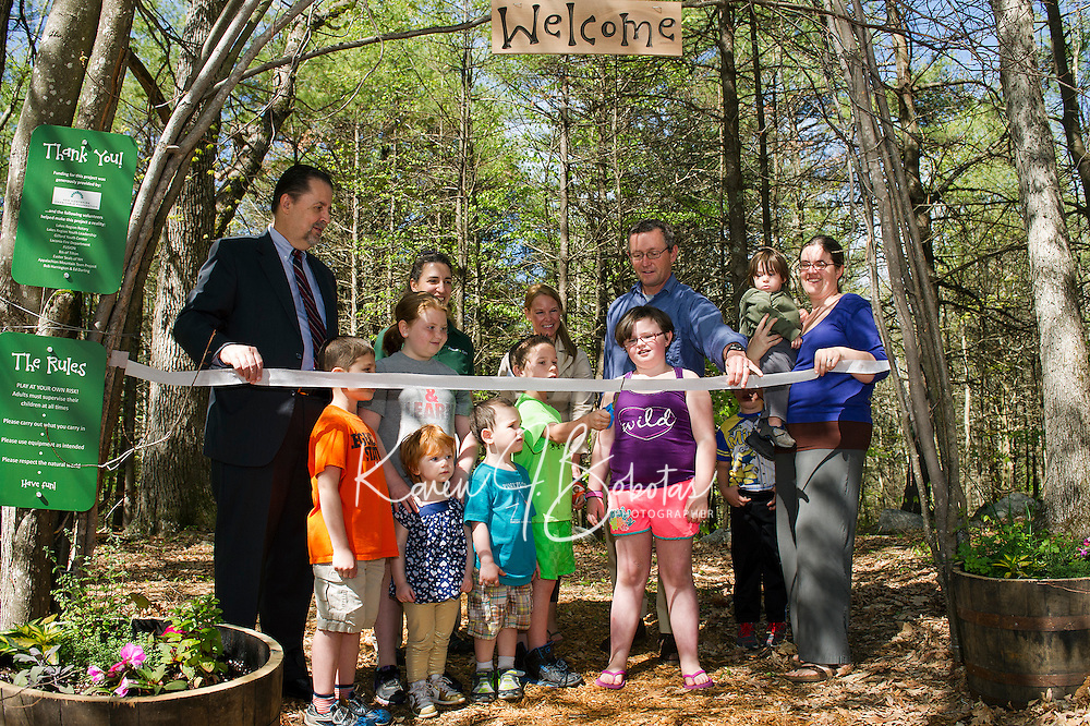 """Mayor Ed Engler, Executive Director Jude Hamel, Director of Marketing Kimberly Drouin, Peter Benson NH Charitable Foundation and Education Director Sarah Dunham-Miliotis are joined by """"ribbon cutter"""" Brandon Lurvey and friends for the official ribbon cutting of the Natural Playscape at Prescott Farm Environmental Education Center on Saturday morning.  (Karen Bobotas/for the Laconia Daily Sun)"""