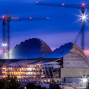 Kauffman Center Construction at Dusk on July 6th, 2010, with construction cranes overhead.