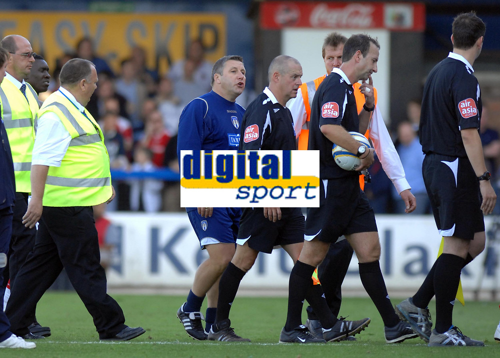 Photo: Ashley Pickering.<br /> Colchester United v Charlton Athletic. Coca Cola Championship. 15/09/2007.<br /> Colchester manager Geraint Williams (blue) has a word with the match officials at the end of the match