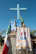 A roadside shrine covered with religious banners as Mexican cowboys gather to join the annual Cabalgata de Cristo Rey cowboy pilgrimage January 4, 2017 in Guanajuato, Mexico. Thousands of Mexican cowboys and horse take part in the three-day ride to the mountaintop shrine of Cristo Rey.