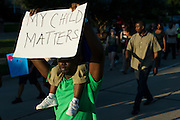 Protesters walk to the community pool at Craig Ranch North in McKinney, Texas on June 8, 2015.  (Cooper Neill for The New York Times)