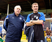 Photo. Daniel Hambury.<br /> Colchester United v Chelsea XI. Pre Season Friendly.<br /> 30/07/2005.                              <br /> Chelsea reserve team coach Mick McGiven and Colchester United manager Phil Parkinson share a moment before kick off.