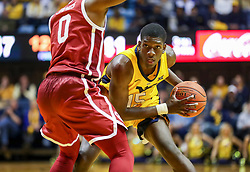 Feb 2, 2019; Morgantown, WV, USA; West Virginia Mountaineers forward Lamont West (15) looks to pass during the second half against the Oklahoma Sooners at WVU Coliseum. Mandatory Credit: Ben Queen-USA TODAY Sports