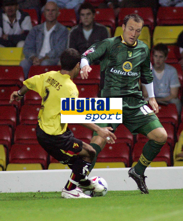 Photo: Paul Thomas.<br /> Watford v Norwich. Coca Cola Championship.<br /> 13/09/2005.<br /> <br /> Norwich's Dean Ashton tries to get round James Chambers.