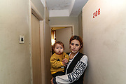 """Veronica is 24 years of age, she is a mother of four children and the fifth, a boy is in her womb. From 11 months the youngest to 7 years the oldest. She is from Askeran, a province nearby Stepanakert in Nagorno Karabakh. She is unemployed and her husband who is from Jabrayil served in the army as volunteer and managed to survive the war as he returned home on the 10th of November after the peace deal was reached between the leaders of Armenia and Azerbaijan. On Tuesday, Dec 28, 2020 - she said that they will not return to Nagorno Karabakh. Her family is now looking for opportunities to work and live in Armenia. They're now under Armenian government logistics support for food, shelter and other essential supplies. She is living at an abandoned building of former """"SOVIET Hotel"""" in Metsamor, which is located near the Armenian Nuclear Power Plant, that is the only nuclear power plant in the South Caucasus, located 36 kilometres west of Yerevan in Armenia. (Photo/ Vudi Xhymshiti)"""