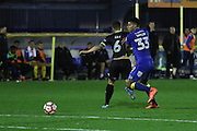 AFC Wimbledon striker Lyle Taylor (33) and Bury FC defender Antony Kay (6) during the The Emirates FA Cup 1st Round Replay match between AFC Wimbledon and Bury at the Cherry Red Records Stadium, Kingston, England on 15 November 2016. Photo by Stuart Butcher.