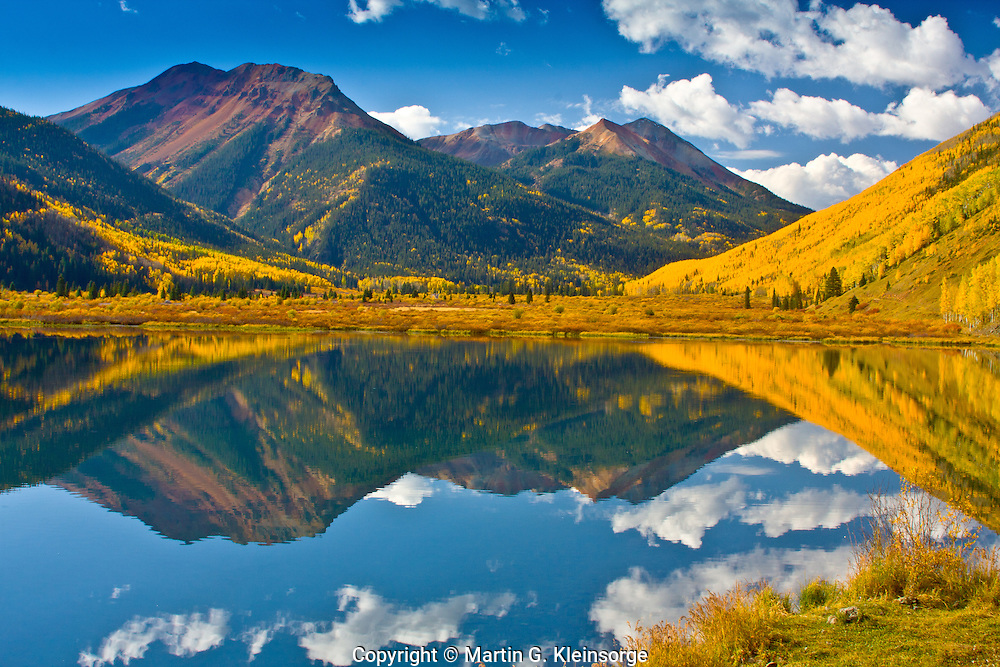 Reflections of Red Mountain in Crystal Lake along the Million Dollar HWY, San Juan Mountains, Colorado.