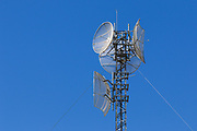 Microwave dish relay  antennas on latitce tower at rural telephone exchange in Goondiwindi, Queensland, Australia <br /> <br /> Editions:- Open Edition Print / Stock Image