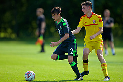 WREXHAM, WALES - Monday, July 22, 2019: Eric Durnell of North (L) and Sebastian Watkins of South (R) during the Welsh Football Trust Cymru Cup 2019 at Colliers Park. (Pic by Paul Greenwood/Propaganda)