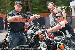 Kurt Allison who hails from West Bend, WI and works at the Menominee Falls HD plant as a machine mechanic helps Lisa Derosier of Milan, NH before test riding a new 2017 Sportster at the Harley-Davidson test ride area that was recently moved right into Weirs Beach for the 2017 Laconia Motorcycle Week, New Hampshire, USA. Sunday June 18, 2017. Photography ©2017 Michael Lichter.