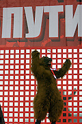 """Moscow, Russia, 06/12/2007..A Putin supporter in a bear costume in front of a banner which reads """"To the future with Putin"""", as approximately 30,000 members of the pro Kremlin youth organisation Nashi [Ours], demonstrate outside the Kremlin in support of President Vladimir Putin, and celebrate the victory of his United Russia party in the recent parliamentary elections."""