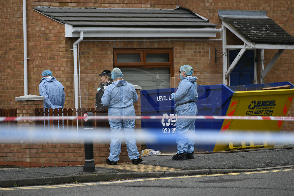 ©Licensed to London News Pictures; 24/07/2021, London UK; Met Forensic officers search for evidence at a house in Goresbrook road, Dagenham, East London after a male in his forties had been assaulted at around 23.55 last night. Despite the best efforts of the emergency services he was prounounced dead at the scene. A 38 year old male was arrested at the scene & his being interviewed by Detectives : Photo credit, Steve Poston/LNP