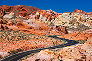 The park road winding through colorful sandstone (hikers visible), Valley of Fire State Park, Nevada USA