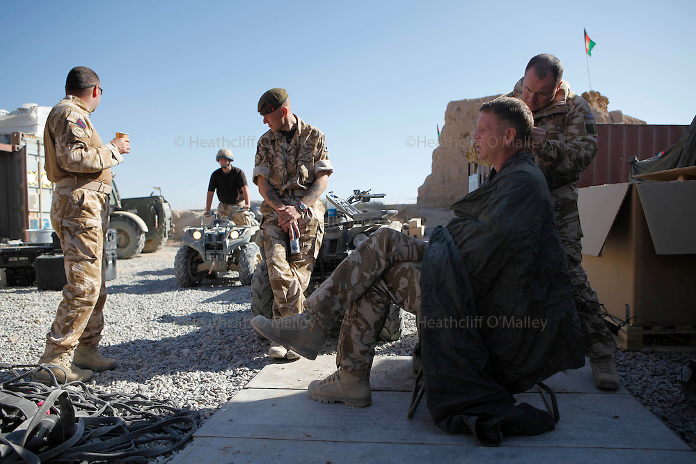 Mcc0018106 . SundayTelegraph..Cptn Bernie Broad getting a haircut  at FOB Shawqat, Helmand province...Afghanistan 14 November 09.