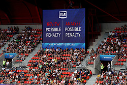 The big screen shows that VAR is reviewing an incident for a possible penalty during the FIFA Women's World Cup, round of Sixteen match at State du Hainaut, Valenciennes.