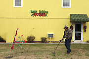 An image from the series Season's Greetings, documenting Christmas in my native North Carolina.<br /> <br /> A man with a metal detector searching for his relatives lost ring on the day after Christmas.  Carolina Beach, NC.