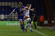 Lee Erwin of Oldham Athletic and Aaron Phillips of Northampton Town battle for the ball during the EFL Sky Bet League 1 match between Oldham Athletic and Northampton Town at Boundary Park, Oldham, England on 16 August 2016. Photo by Simon Brady.