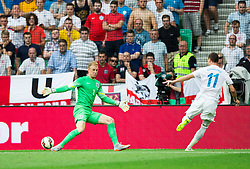 Milivoje Novakovic of Slovenia scores first goal for Slovenia against Joe Hart of England during the EURO 2016 Qualifier Group E match between Slovenia and England at SRC Stozice on June 14, 2015 in Ljubljana, Slovenia. Photo by Vid Ponikvar / Sportida