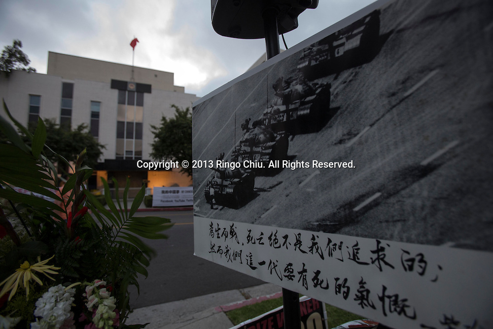 Flowers and pictures are placed during a candlelight vigil for the 24th anniversary of June 4 Tiananmen Square Massacre in Beijing at outside of The Consulate General of the PRC on June 4, 2013 in Los Angeles. (Photo by Ringo Chiu/PHOTOFORMULA.com)