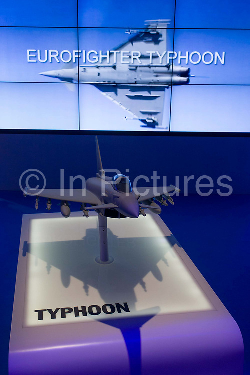 Video presentation of the BAE Systems Typhoon jet fighter presentation model, exhibited at the Farnborough Air Show, England. The Typhoon was designed and is manufactured by a consortium of three companies; BAE Systems, Airbus Group and Alenia Aermacchi, who conduct the majority of affairs dealing with the project through a joint holding company, Eurofighter Jagdflugzeug GmbH, which was formed in 1986. The project is managed by the NATO Eurofighter and Tornado Management Agency, which also acts as the prime customer. BAE Systems plc is a British multinational defence, security and aerospace company headquartered in London in the United Kingdom and with operations worldwide.