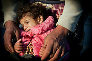 Zakhia, 3, is crying in her home in Fallujah, Iraq. The parents and their relatives have no history of birth defects.