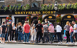 Edinburgh, Scotland, UK. 22nd August 2021. Good weather brought many visitors to Edinburgh during the festival and many came to pay respects to the Greyfriars Bobby statue on Candlemaker Row in the Old Town. . Iain Masterton/Alamy Live News.