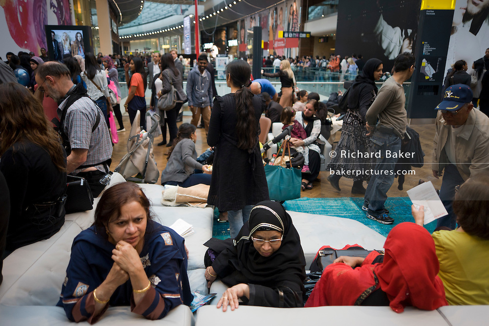 Londoners crowd inside during the opening day of the Westfield Stratford shopping mall. Situated on the fringe of the 2012 Olympic park, Westfield hosted its first day to thousands of shoppers eager to see Europe's largest urban shopping centre. The £1.45bn complex houses more than 300 shops, 70 restaurants, a 14-screen cinema, three hotels, a bowling alley and the UK's largest casino. It will provide the main access to the Olympic park for the 2012 Games and a central 'street' will give 75% of Olympic visitors access to the main stadium so retail space and so far 95% of the centre has been let. It is claimed that up to 8,500 permanent jobs will be created by the retail sector.