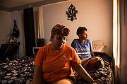 MONTGOMERY, AL – JUNE 11, 2019: Myra Powell (left) sits in the apartment she rents with her fiancé, Stefvenie Buckner, in the Capitol Heights neighborhood. At age 19, while 26 weeks pregnant, Powell suffered a catastrophic placental abruption and was taken by ambulance to a nearby hospital. While there, doctors discovered her placenta had fully detached from the uterine wall, depriving her twin boys of oxygen. Silas and Stefvon died in utero. Narrowly escaping death herself, Powell would later be diagnosed with HELLP syndrome, a pregnancy-induced blood pressure condition in the eclampsia family that kills nearly a third of all women who develop it. As a young, poor, black woman from the south, Powell represents the deadliest cross-section of demographics among mothers in America, where more women die from pregnancy related causes than any other wealthy country in the world.