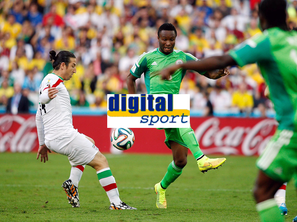 Curitiba June 16 2014  Iran s Andranik Timo Tian l Compet with Nigeria s John Obi Mikel  A Group F Match between Iran and Nigeria of 2014 FIFA World Cup AT The Arena there Baixada Stage in Curitiba Brazil June 16 2014World Cup 2014 <br /> Iran - Nigeria<br /> <br /> Norway only