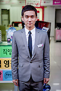 Portrait of a store clerk working in a mobile phone shop in the South Korean city of Daegu.