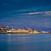 Queen Victoria docked against the Liverpool skyline