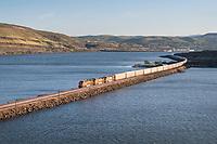 Freight train along Columbia River near The Dalles Oregon