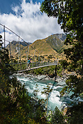 Rob Roy Track swing bridge, Mount Aspiring National Park, Southern Alps, Otago region, South Island of New Zealand. Photographed in 2019, this 2013 bridge replaced the original 1987 bridge. In 1990, UNESCO honored Te Wahipounamu - South West New Zealand as a World Heritage Area. This image was stitched from multiple overlapping photos.