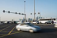 Cars drive on the Corniche in Doha, Qatar
