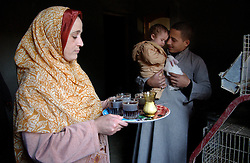 Fayoume, EgyptManal, 27, serves tea to Wael, 16  in the village of Hamidia in Fayoume, Egypt December 7, 2005.  Wael is taking part in a rabbit telefood program funded by FAO..(Photo Ami Vitale)