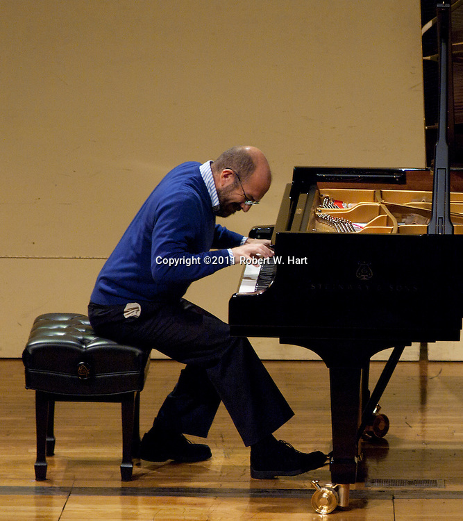 Competitor Andrea De Tomas performs a selection by Lizst during the Van Cliburn Sixth International Piano Competition for Outstanding Amateurs Tuesday May 24, 2001 afternoon at Ed Landreth Auditorium on the TCU campus. Special Contributor/Robert W. Hart