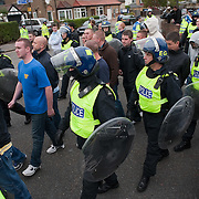 LONDON, ENGLAND - SEPTEMBER 11:  Alleged members of English Defence Leagues protesting against the Harrow Central Mosque are contained and moved away from the mosque  on September 11, 2009 in London, England.  (Photo by Marco Secchi/Getty Images)