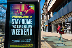 Edinburgh, Scotland, UK. 8 April 2020. Images from Edinburgh during the continuing Coronavirus lockdown. Pictured; Video screen with Coronavirus health message advising the public to stay indoors over Easter weekend. Iain Masterton/Alamy Live News.