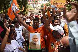 May 23, 2019, Mumbai, India: Supporters of Indian Prime Minister Narendra Modi and the ruling Bharatiya Janata Party (BJP) celebrate outside the BJP headquarters in Mumbai. Indian Prime Minister Narendra Modi on Thursday praised the ruling Bharatiya Janata Party (BJP)'s performance in India's just-concluded elections as trends in the ongoing vote counting showed the BJP on a winning streak. (Credit Image: © Fariha Farooqui/Xinhua via ZUMA Wire)