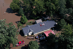 August 22, 2017 - USA - Overland Park Fire Department officials are staged at 151st Street just west of Kenneth Road waiting for floodwaters to recede before attempting to rescue a family of seven stranded on the roof of their home near 155th Street and Kenneth Road. (Credit Image: © Rich Sugg/TNS via ZUMA Wire)