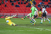 Forest Green Rovers Mark Ellis(5) shoots at goal and is saved by Gateshead goalkeeper James Montgomery(1) during the Vanarama National League match between Gateshead and Forest Green Rovers at Gateshead International Stadium, Gateshead, United Kingdom on 18 February 2017. Photo by Shane Healey.